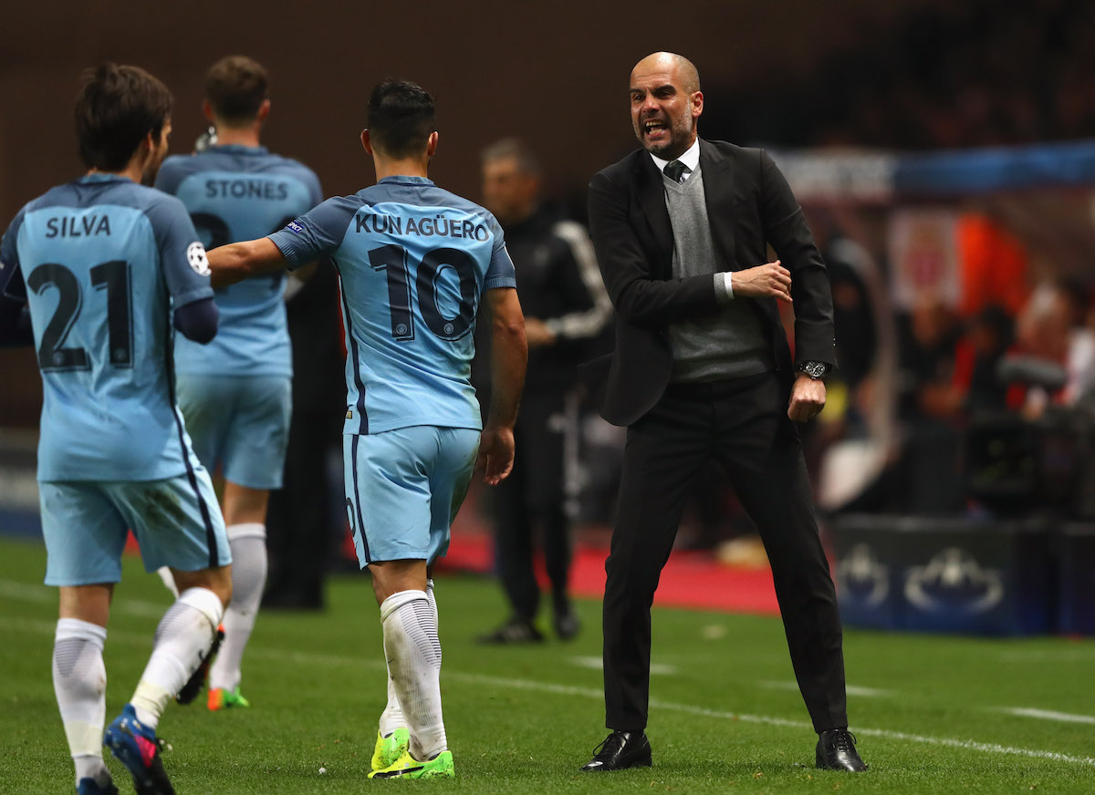 Manchester City manager Pep Guardiola gives instructions to Sergio Aguero and David Silva against Monaco in the Champions League