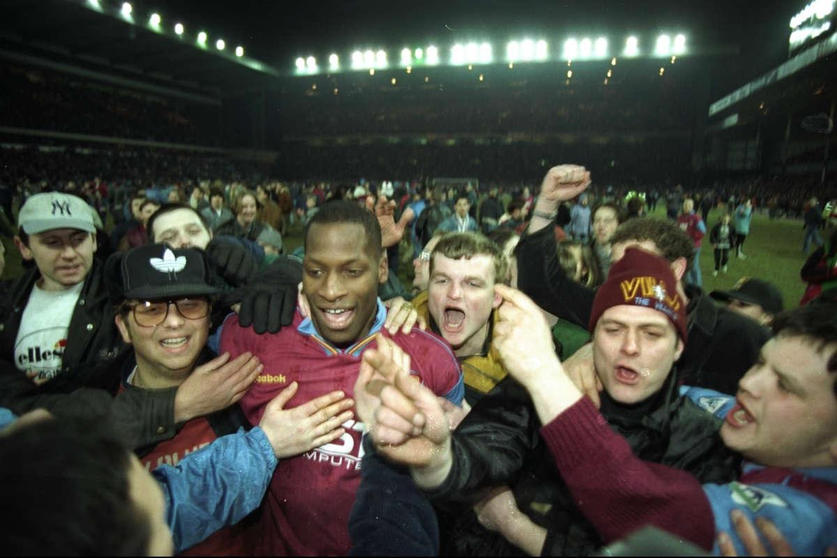 Ugo Ehiogu surrounded by Aston Villa fans